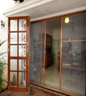 Screen doors are both robust and aesthetically pleasing . they offer durable  effective protection against insects. the doors frames have mitered  corners ... & Mosquito Net Doors for Kitchen Main doors in Bangalore   Spectra ... Pezcame.Com